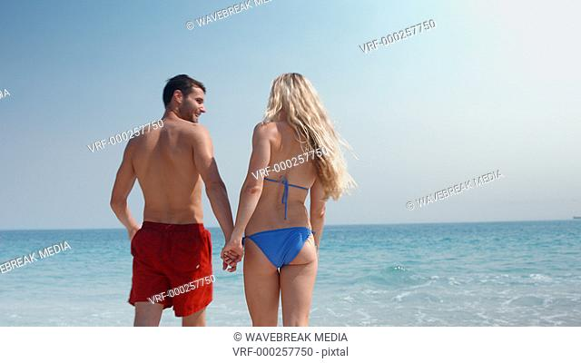 Cute couple walking on the beach