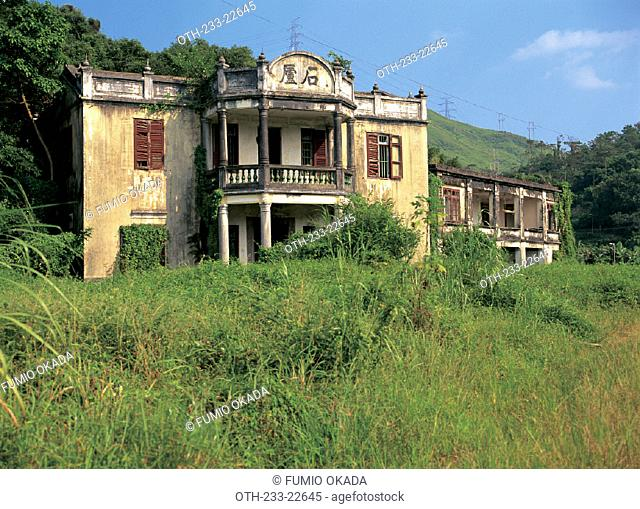 An abandoned house in colonial style in Fanling, Hong Kong
