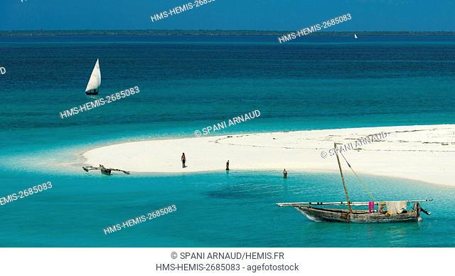 Tanzania, Zanzibar, Kendwa, playing children on a white sand tongue lapped by turquoise waters