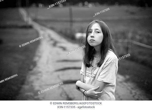 Girl at end of driveway