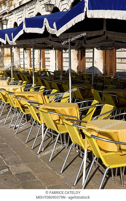 Terrace of a cafe on St Mark's Square at early morning