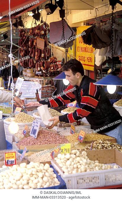 Nut vendor serving customer , Istanbul, Turkey, Middle East