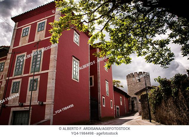 The House of Culture, in the old town of Llanes. In the background, the tower of the wall .Llanes, Asturias, Spain
