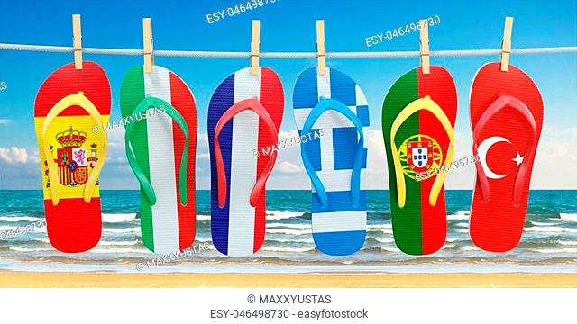 Hanging flip flops in colors of flags of different mediterranean european countries Spain, Italy, France, Portugal, Greece and Turkey