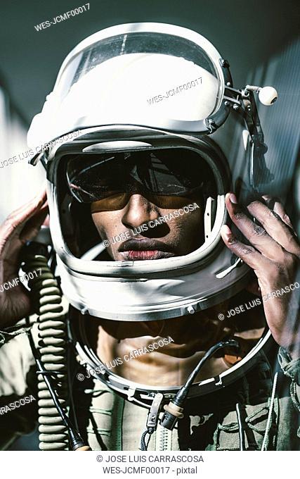 Portrait of serious astronaut in spacesuit