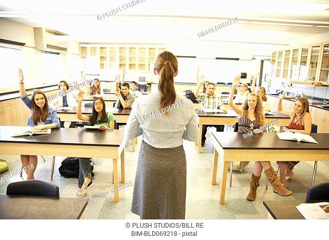 Female school teacher teaching in classroom