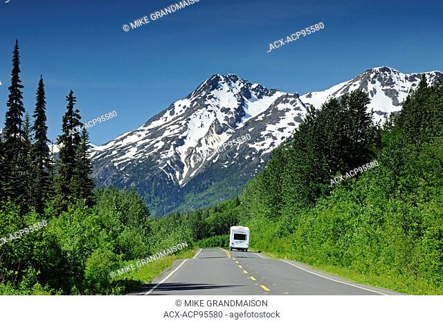 Camper traveling on the Stewart Cassiar Highway and mountains Stewart Cassiar Highway British Columbia Canada