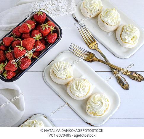 baked meringue with cream and fresh strawberries, dessert pavlova