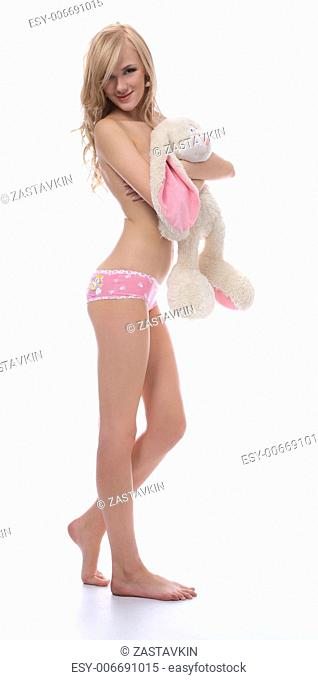 beautiful topless blonde model closes her chest with toy bunny