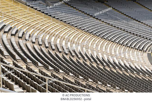 Empty chairs in stadium