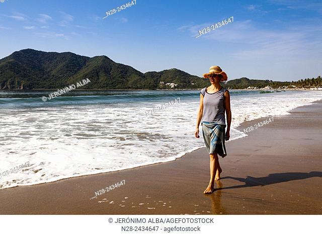 Woman walking on the beach, Pacific Ocean, Manzanillo, Colima, Mexico