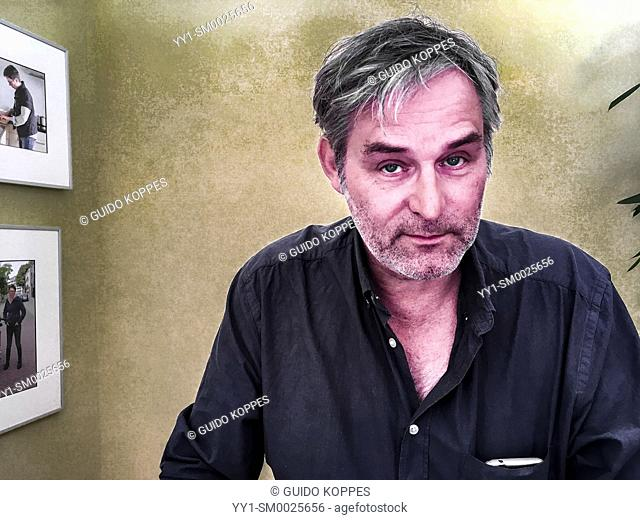 Tilburg, Netherlands. A mature adult, caucasian photography student working hard during a workshop stockphotography inside Studio Tuinstraat