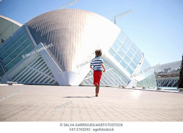 A boy running in the City of Arts and Sciences, Valencia, Europe