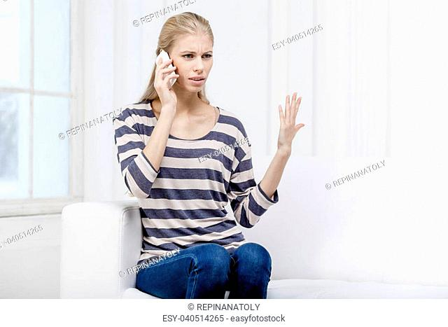 young beautiful blond woman sitting on the couch