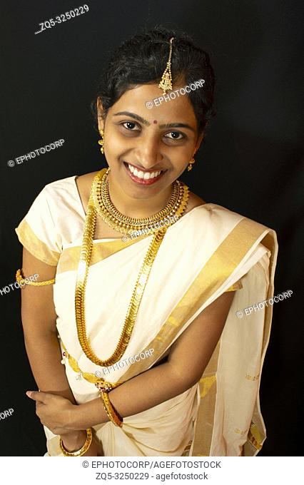 Young girl in traditional Kerala saree and jewelry