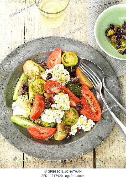 Tomato and olive salad with goat's cheese