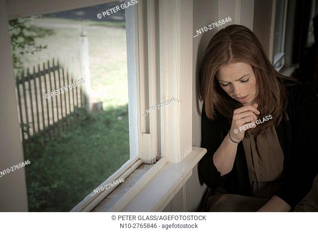 Young woman by a window