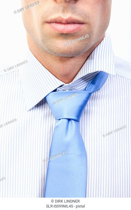 Young man with messy shirt and tie