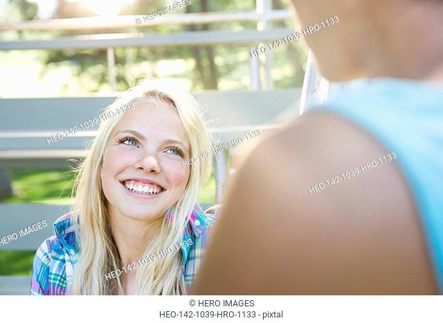 Smiling teenage girl looking up at boy