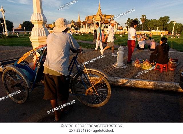 Resting at Royal Palace outside. Phnom Penh. The Royal Palace of Cambodia is a complex of buildings, even though it is generally understood to be the royal...