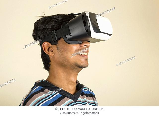 Amazed young boy experiencing virtual reality headset