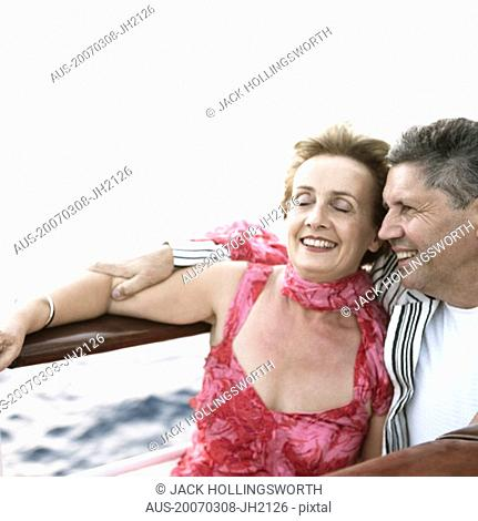 Mature woman and a senior man smiling in a ship