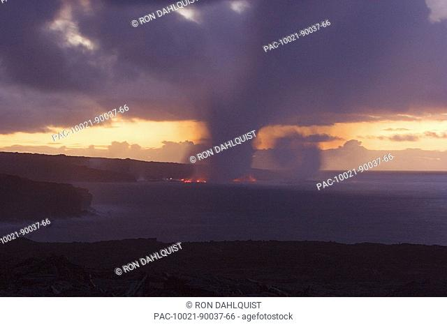 Hawaii, Big Island, Kalapana, Steam cloud formed by lava entering Pacific Ocean from Kilauea
