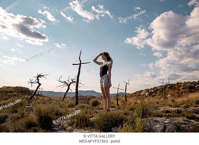 Young woman in the countyside looking out