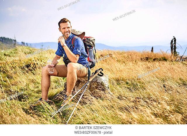 Smiling man resting during hiking trip