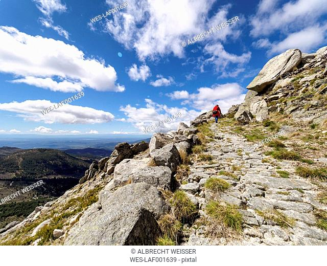Spain, Sierra de Gredos, man hiking in mountains