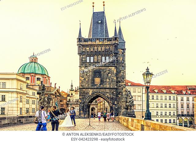 Prague, Czech Republic - August 17, 2018: Wedding couple on Charles Bridge, morning photo session
