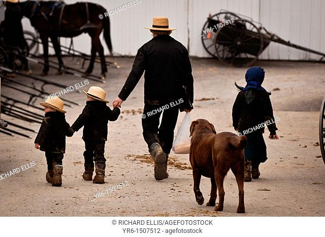 Amish family walks together holding hands in Gordonville, PA