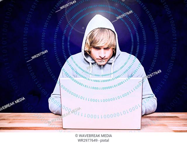 Blond hair hacker using a laptop in front of blue background