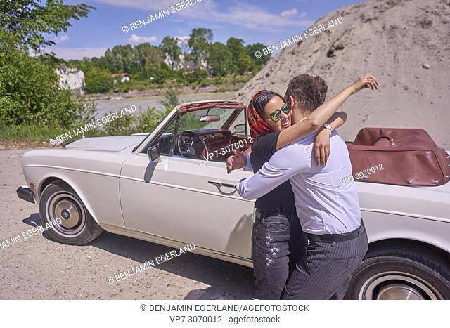 Couple at luxus oldtimer. Turkish ethnicity. High society. Bloggers Adem Bayalan and Emine Feruz Bayalan. Bavaria, Germany
