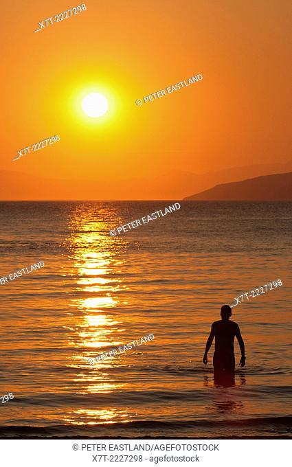 Sunset across the Messinian Gulf at Kalogria beach, Stoupa, in the Outer Mani, Southern Peloponnese, Greece