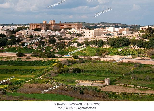 View of the Naval Hospital in Mtarfa from the bastion on Pjazza Tas-Sur, Mdina, Malta  A hospital during WWII the building now houses a secondary school