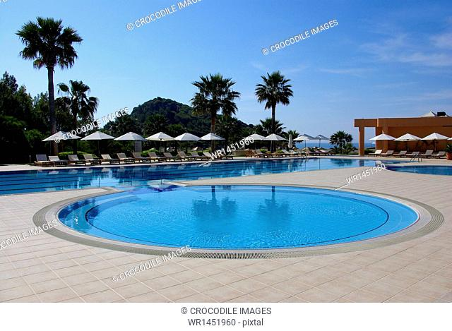 Swimming pool of a hotel with view to beach, Mediterranean Sea, Southwestern Turkey