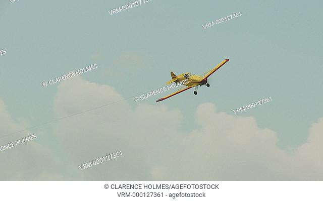 ELMIRA, NY - AUGUST 2: A Piper Pawnee towplane lands after an aerotow during the 2013 SSA Region 3 Soaring contest at Harris Hill gliderport on August 2