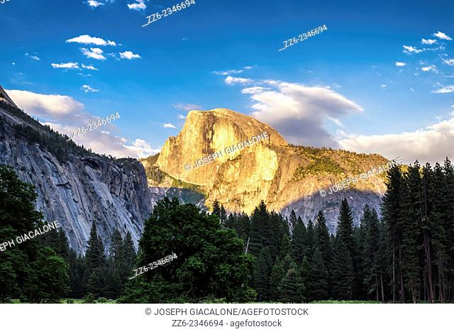 The setting Sun illuminating Half Dome. View from Yosemite Valley. Yosemite National Park, California, United States