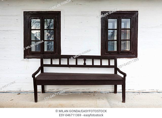 Bench and windows of a traditional house in Slovany village, northern Slovakia