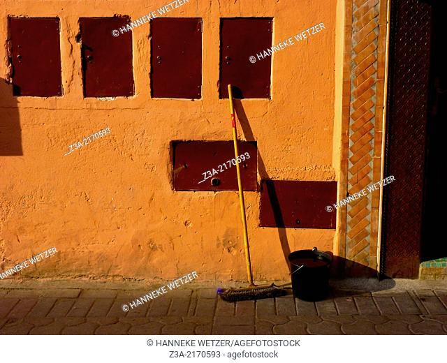 A broom and a bucket of water in the streets of Marrakech, Morocco