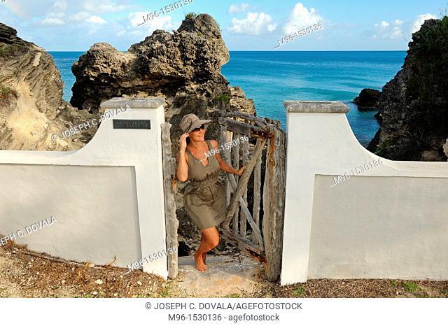 Woman opening gate, Bermuda Island, Atlantic