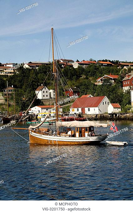 The old fishing boat (now working as a private touring ship) Tvende Brödre (meaning Two Brothers) of Farsund, Norway, entering Kristiansund Harbour in the...