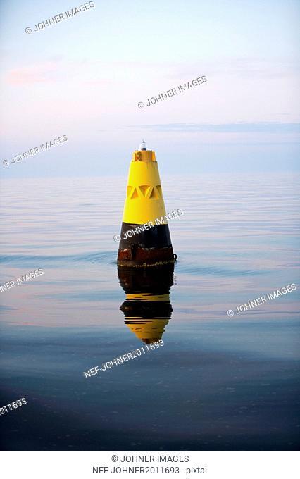 Yellow cone at sea