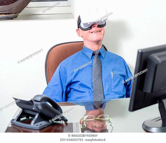 Smiling corporate executive wearing virtual reality headset
