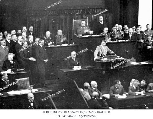 The image from the Nazi Propaganda! shows Reich Chancellor Adolf Hitler delivering a speech to the Reichstag in the Kroll Opera House in Berlin, Germany
