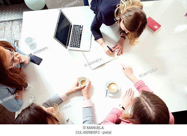 Businesswoman and colleagues having meeting in office