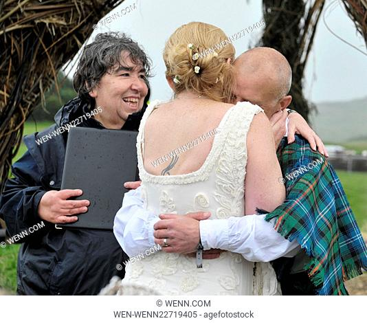 Day two of the Wickerman Music Festival 2015 in Dumfries, Scotland. The day started with the wedding of Suzanne Rutter and Alex Urquhart from Dundee