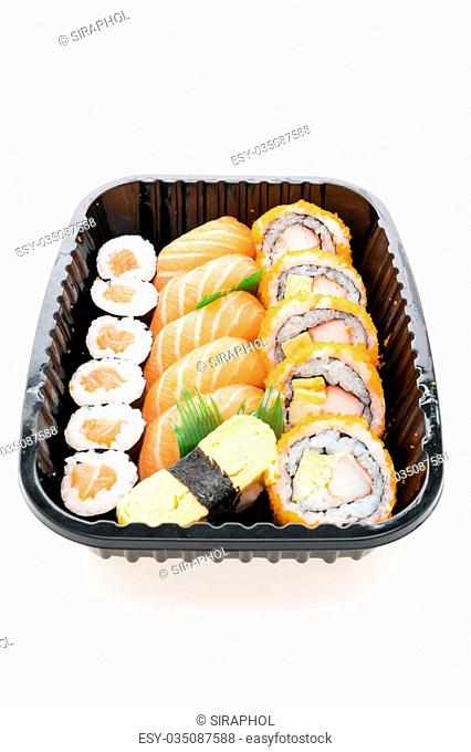 Sushi box with roll fresh salmon sushi , raw fresh salmon meat sushi rice , California roll maki , and Sushi sweet egg in black box isolated on white background...