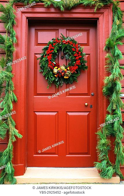 A holiday wreath stands prominently on a colonial door in Williamsburg, Virginia